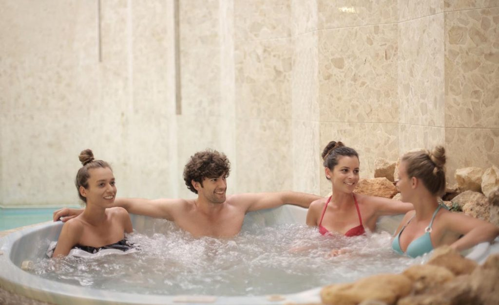 group-of-people-in-a-hot-tub